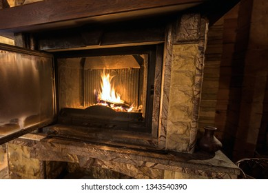 Yellow blazing flame in the cabin fireplace