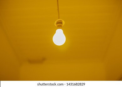 Yellow blub lighting up room