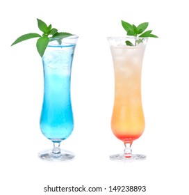 yellow and blue alcohol cosmopolitan martini cocktails drinks with mint in cocktail glass isolated on a white background