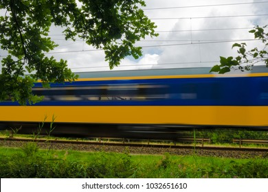 A yellow and blue Dutch train passing by, Groningen, The Netherlands