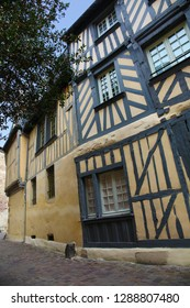 Yellow and blue facade of medieval house in the historic center of Rennes city, Brittany, France