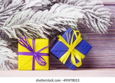 Yellow and blue gift boxes over holiday background