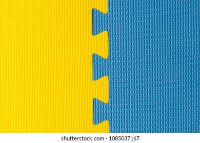 Yellow and blue interlocking rubber foam flooring for babies and children indoor activity, top view