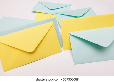 yellow and blue letter envelopes on white backgrounds