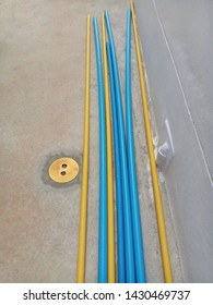 Yellow and blue PVC pipe lay on concrete floor. Construction material. Polyvinyl chloride tube yellow color use for electric wire and blue color use for water system.  Rigid PVC pipe. Metal pipe cap.