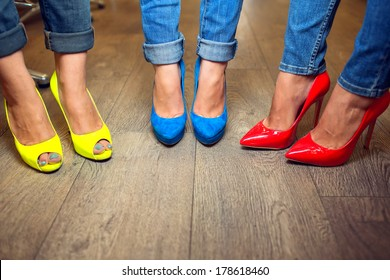 Yellow blue red shoes on female FEET