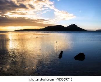 Yellow and blue sunrise of Truk Lagoon