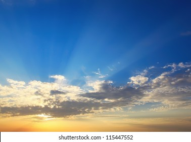 Yellow blue sunset sky with sunlight