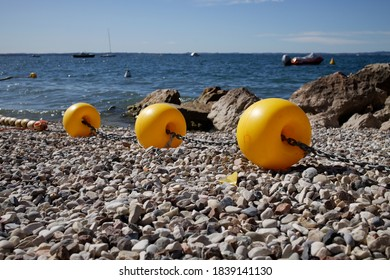 Yellow Border Buoys by a Beach