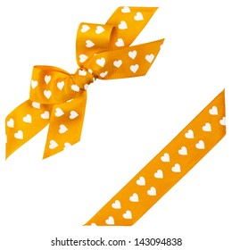 yellow bow with hearts and ribbon