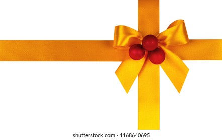Yellow bow, ribbon with christmas balls. Isolated on white background.