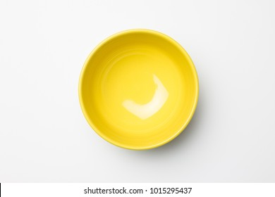 Yellow bowl on white background