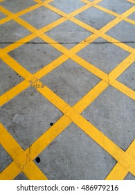 the yellow box junction markings area.No parking yellow cross zone. Yellow box junction (criss-cross yellow lines painted on the road)