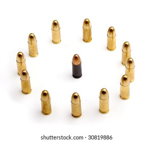 yellow brass bullets standing around a copper bullet