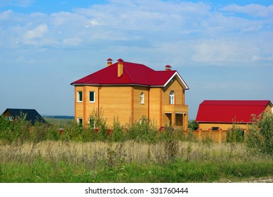 Yellow brick house with red roof photo
