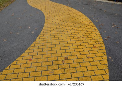 a yellow brick path or trail