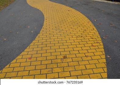 a yellow brick path or trail