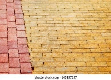 Yellow Brick paving edged with red bricks