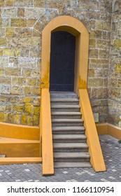 yellow brick tower,exterior door with stairs - Shutterstock ID 1166110954