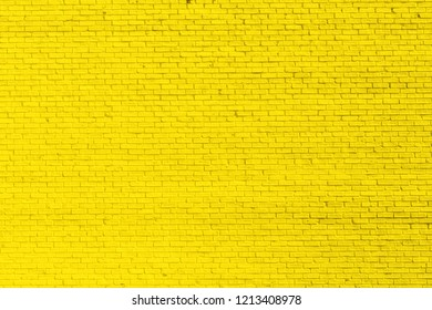 Yellow brick wall background or texture