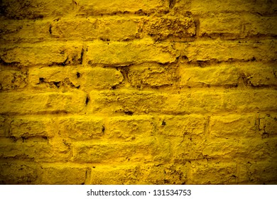A yellow brick wall for background or texture usage