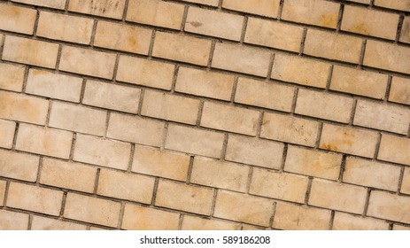 Yellow brick wall surface as background image