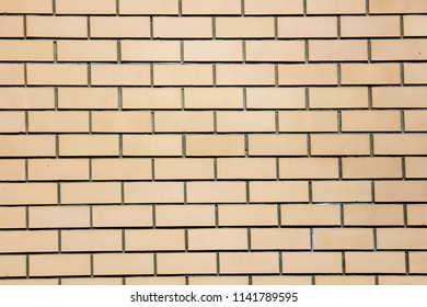 Yellow bricks in the wall as an abstract background