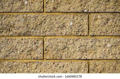 Muro de ladrillos amarillos. Textura de ladrillos. Fondo de ladrillo.