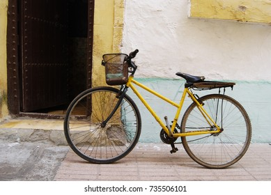 Yellow bright bicycle in medina, Morocco