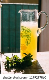 Yellow bright sunny lemonade with mint in a jar. Summer cold drink