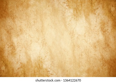 Yellow brown stained paper. Rustic grunge parchment. Empty copy space antique secret message background.