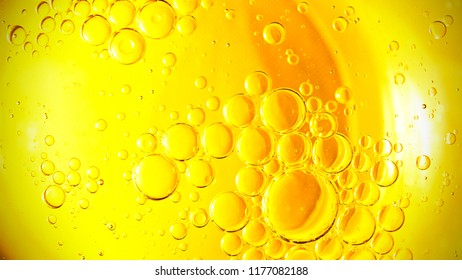 Yellow bubbles background, cooking oil emulsion, frying.
