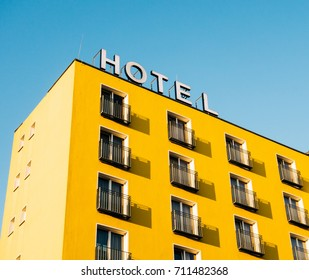 yellow building with hotel sign