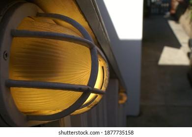 yellow bulb on staircase in beachhouse