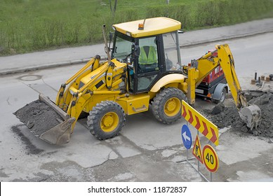 Yellow bulldozer with construction signs