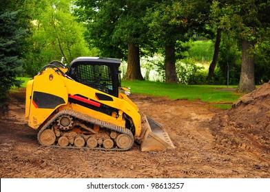 yellow bulldozer in construction site