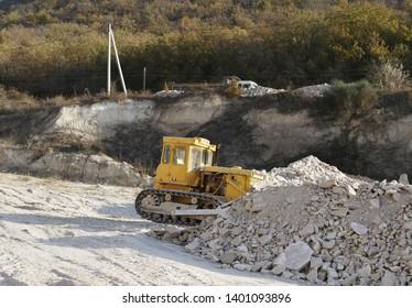 yellow bulldozer on construction site.