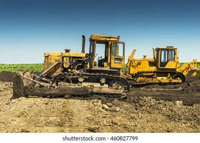 yellow bulldozer on a sunny day in the field
