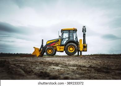 Yellow bulldozer overcome barrier