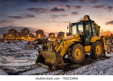 Yellow bulldozer at winter