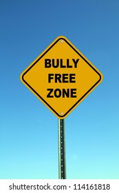 Yellow bully free zone road sign on bright blue sky background