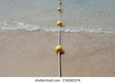 Yellow buoy or Tiny Boundary Buoy In Thailand, it is called fish eggs buoy. Which is a buoy floating in the sea with rope borders To divide into the swimming area for tourists.