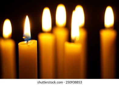 yellow burning candles