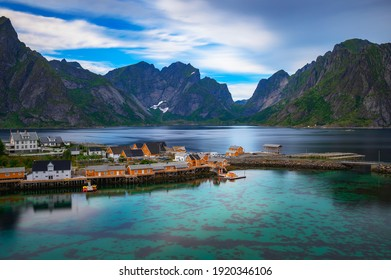 Yellow cabins called rorbuers and turquise waters of Sakrisoy fishing village on Lofoten islands in Norway. Long exposure.