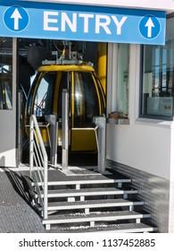 yellow cable car ski lift entrance