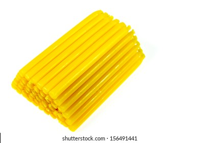 Yellow candle isolated on white background