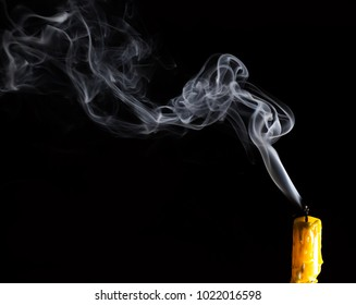 Yellow Candle with white smoke on black background / Select focus for adjustment  make smoke brush tool