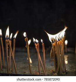 Yellow Candles Burning, close up
