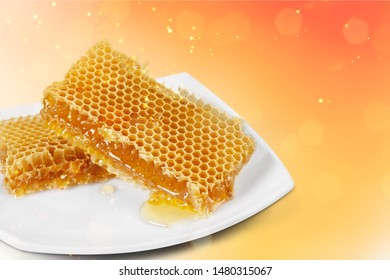 Yellow candy honeycomb wax on a white plate