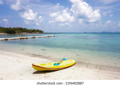 yellow canoe on the beach with beautiful sea blue sky